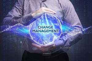 Business Technology Internet and network concept. Young businessman shows the word: Change management